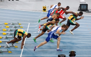 Usain Bolt of Jamaica (R) makes a false start as Nesta Carter of Jamaica stays in the blocks in the men's 100 metres final at the IAAF World Championships in Daegu August 28, 2011. Bolt false started and was disqualified from the world athletics championships 100 metres final on Sunday.   REUTERS/Kim Kyung-Hoon (SOUTH KOREA  - Tags: SPORT ATHLETICS IMAGE OF THE DAY TOP PICTURE)